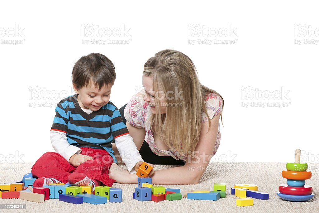 Playing on the carpet mother and a little son stock photo