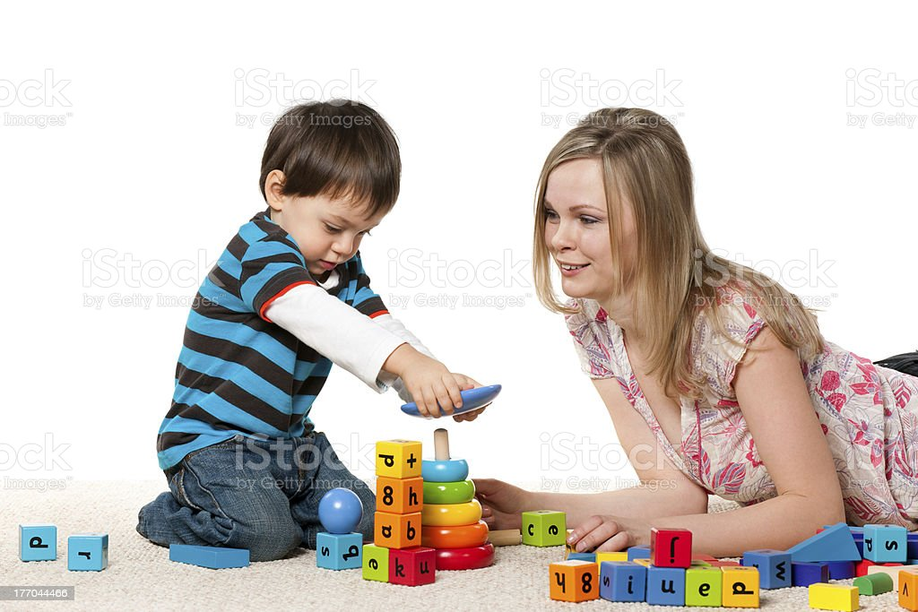 Playing on the carpet mother and son royalty-free stock photo