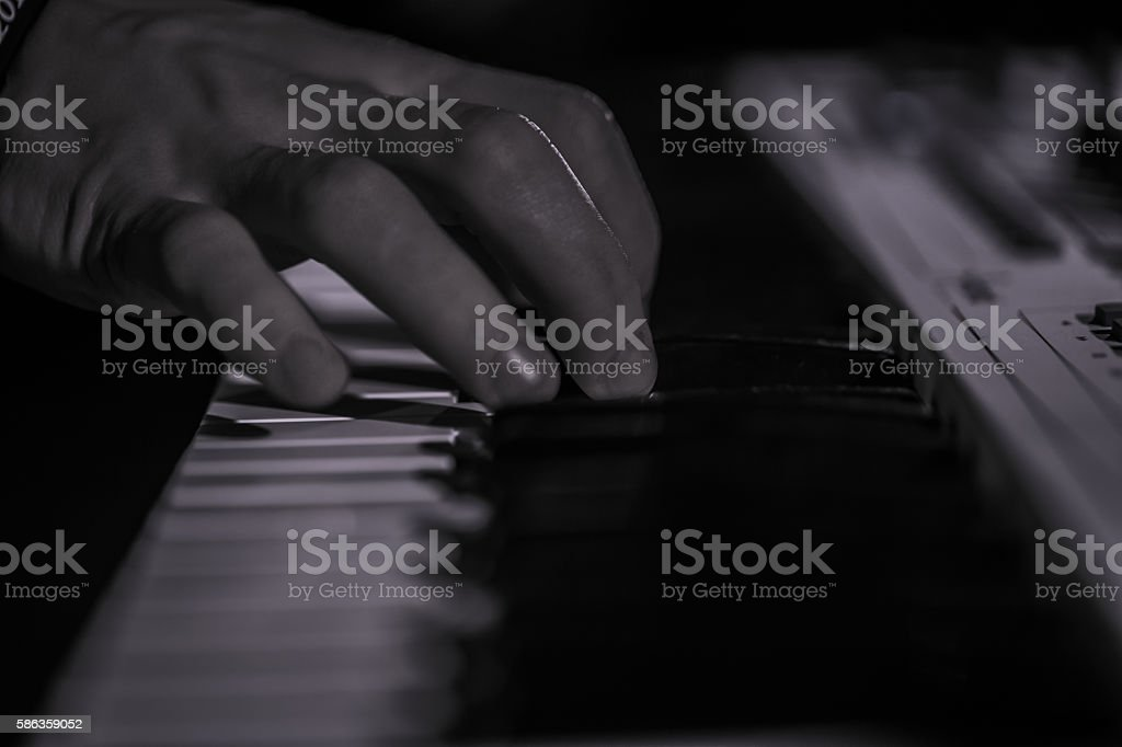 playing on the digital piano. The shallow depth of field stock photo