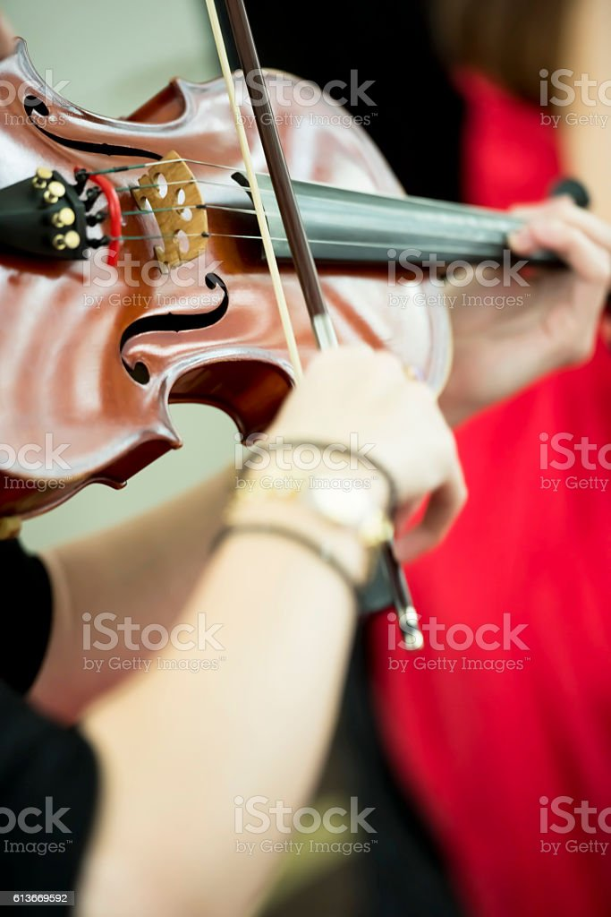 Playing on the instrument stock photo