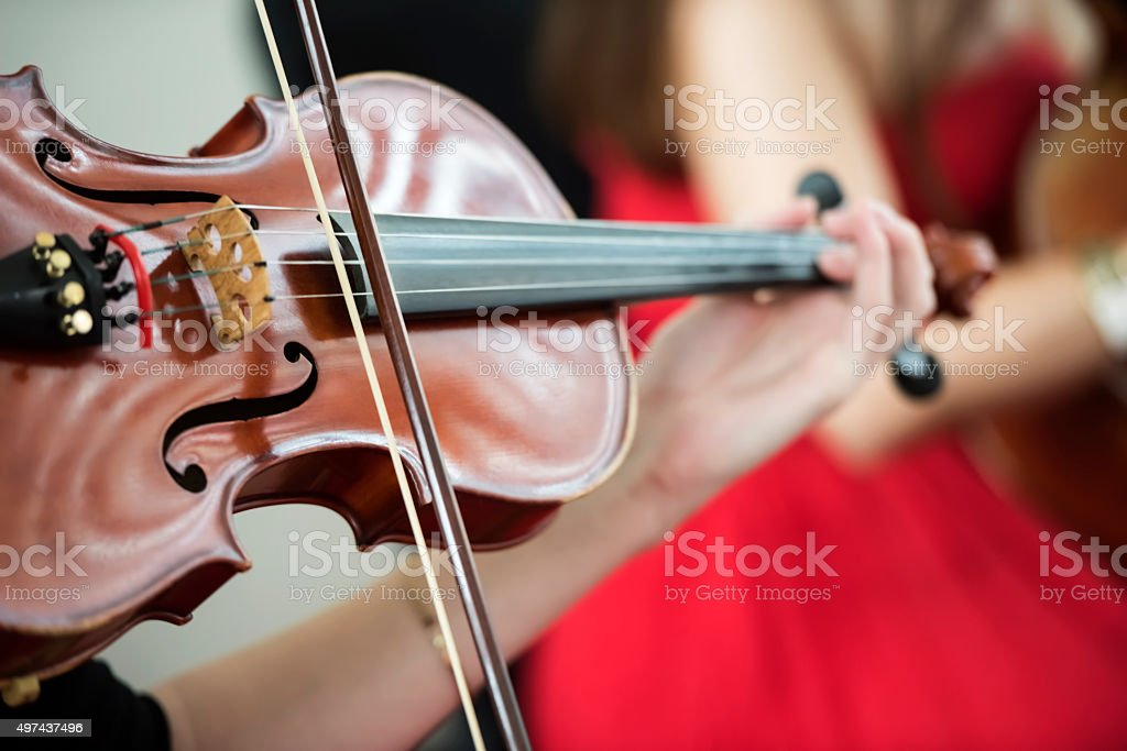 Playing on the violin stock photo