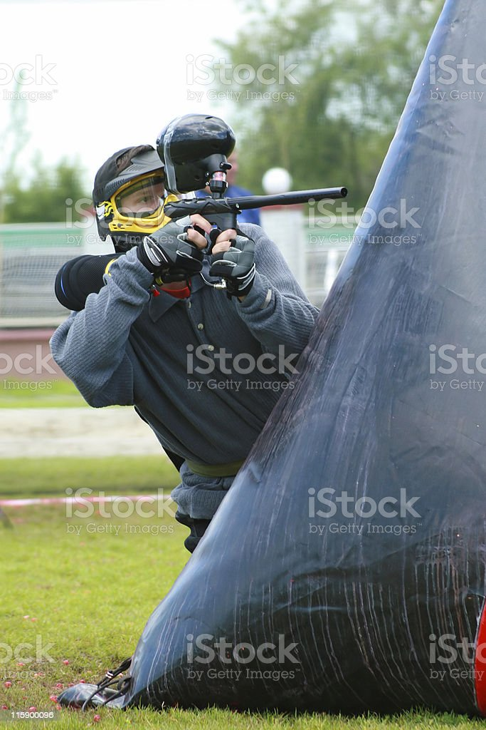 Playing paintball stock photo