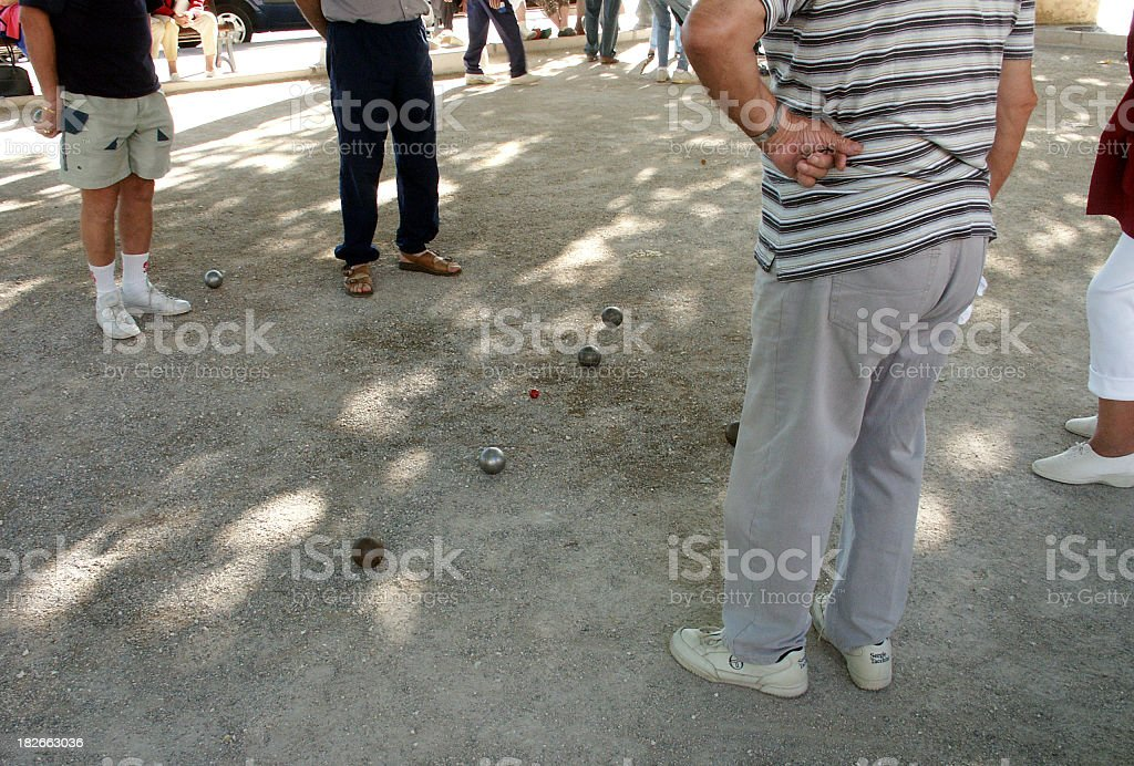 Playing petanque, jeu de boules,  in France royalty-free stock photo