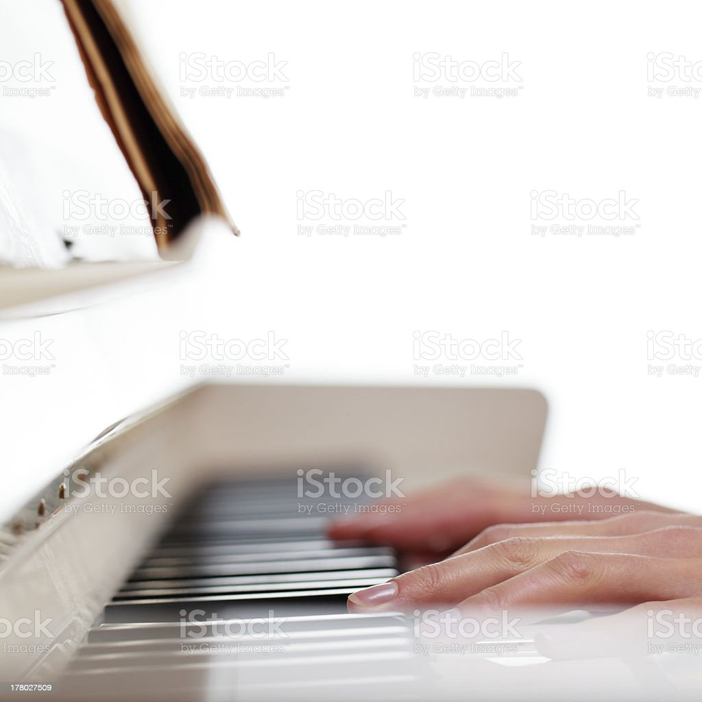 Playing Piano (shallow DOF; color toned image) royalty-free stock photo