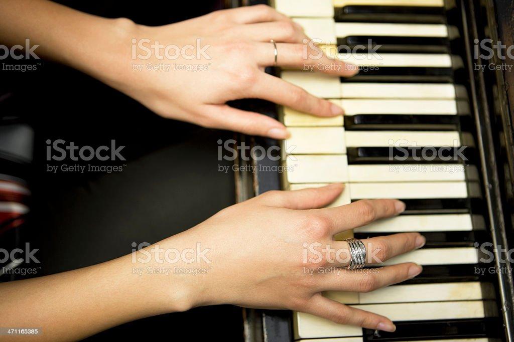 Playing piano XXXL royalty-free stock photo