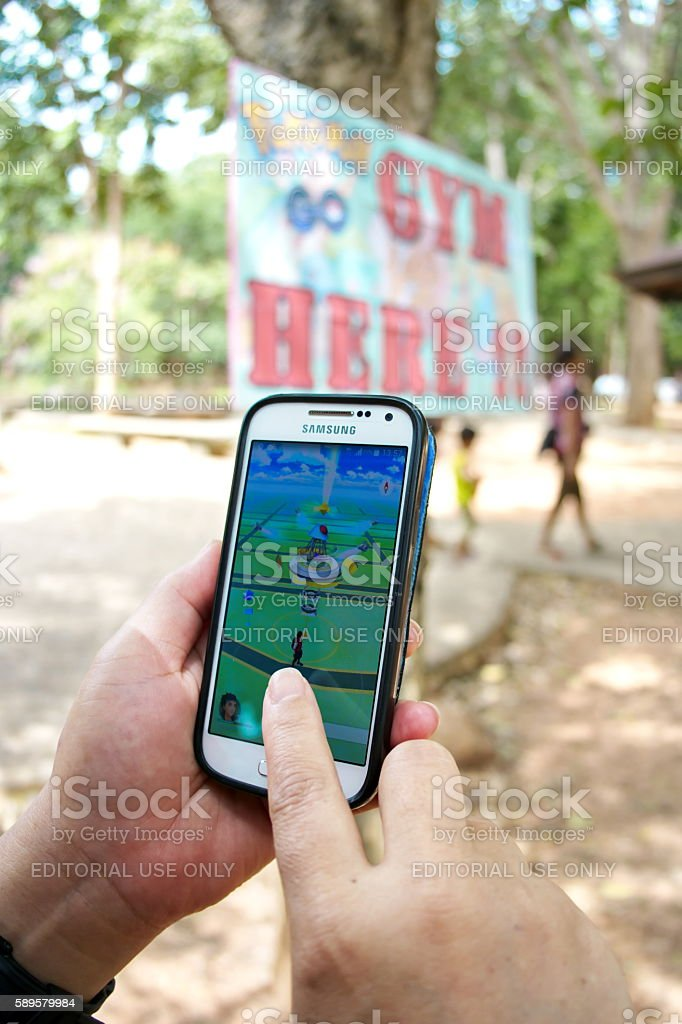 Playing Pokemon Go on a smart phone. stock photo