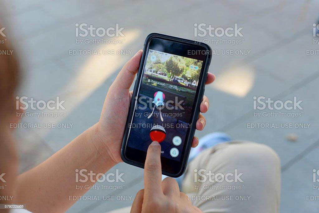 Playing Pokemon Go stock photo