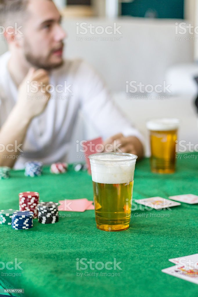 Playing Poker at home with friends stock photo