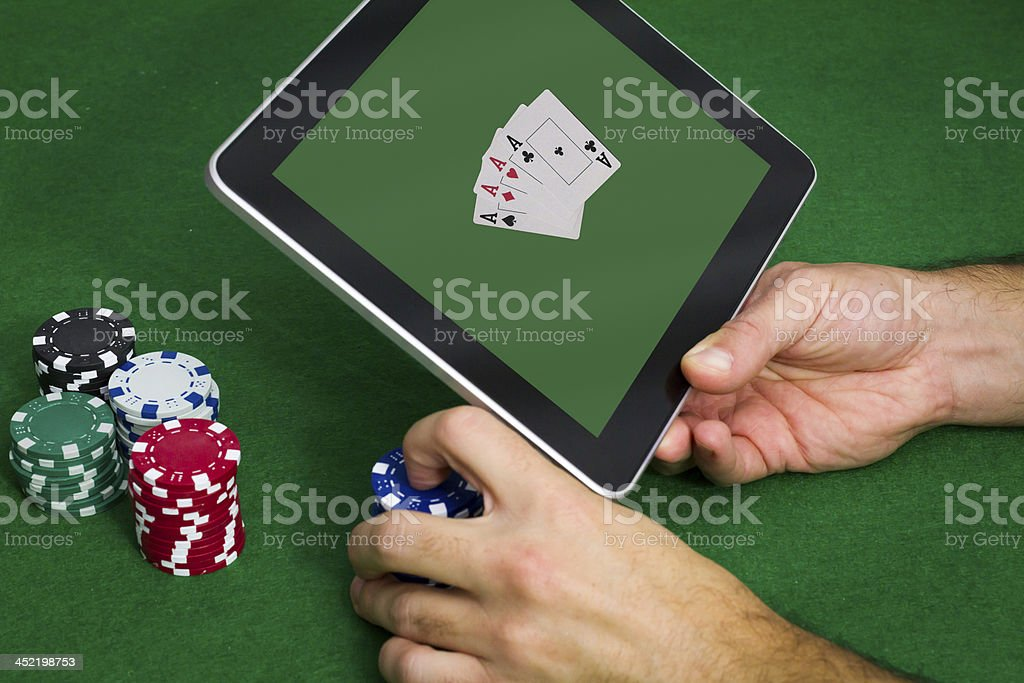 Playing Poker On-line stock photo
