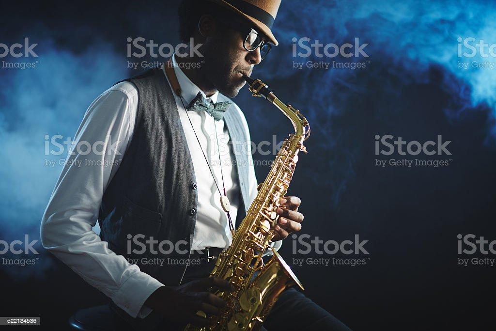 Playing sax stock photo