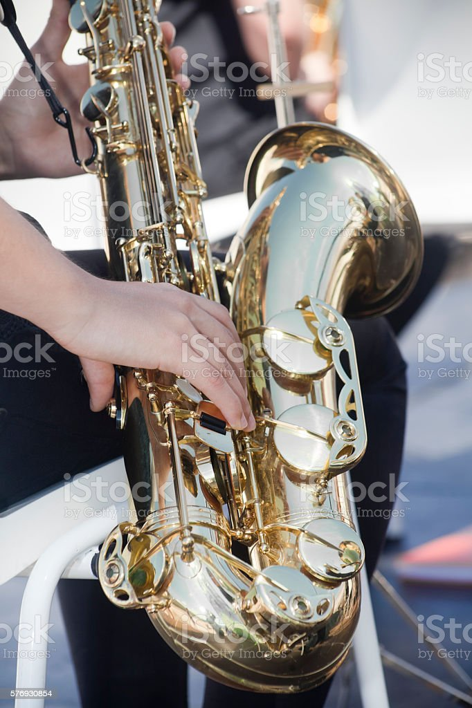 Playing saxophon in an open air concert. stock photo