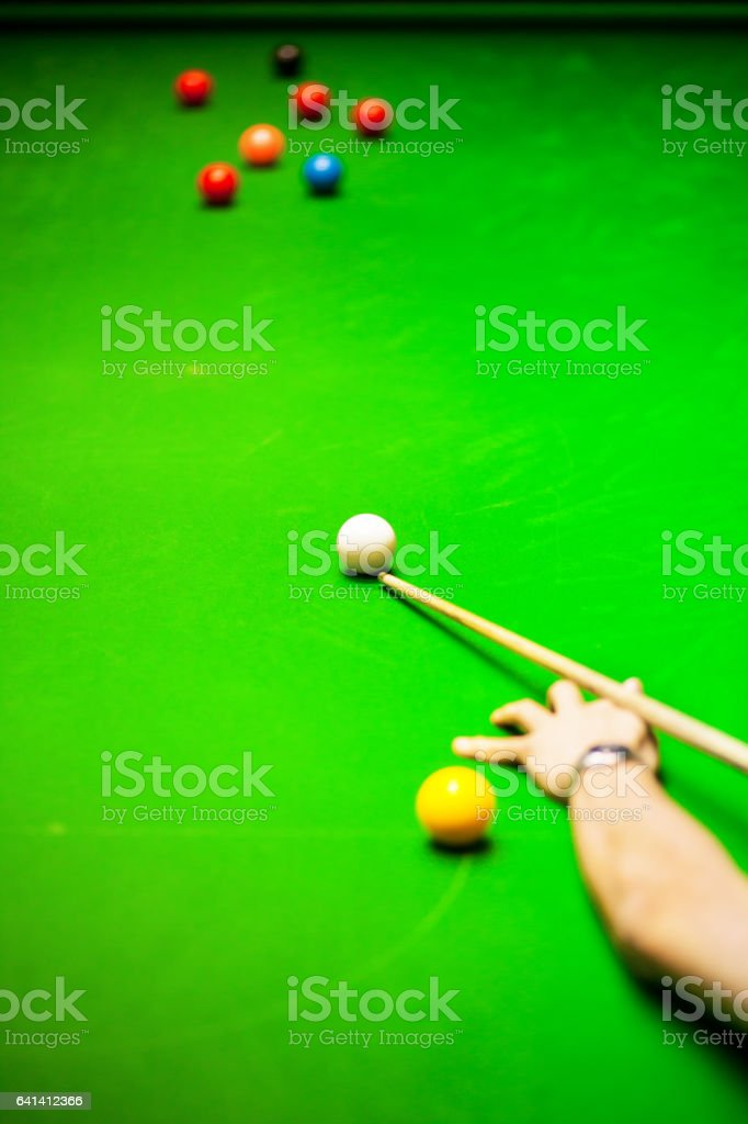 Playing snooker and aiming white ball stock photo