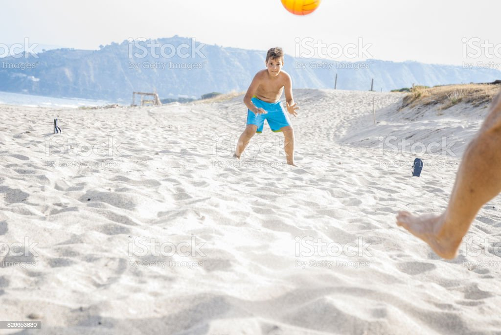 Playing Soccer at the Beach stock photo