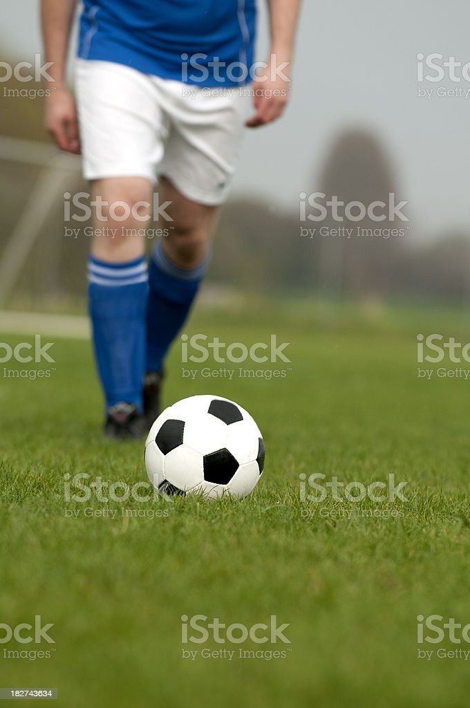 Playing soccer on a football field in the spring royalty-free stock photo