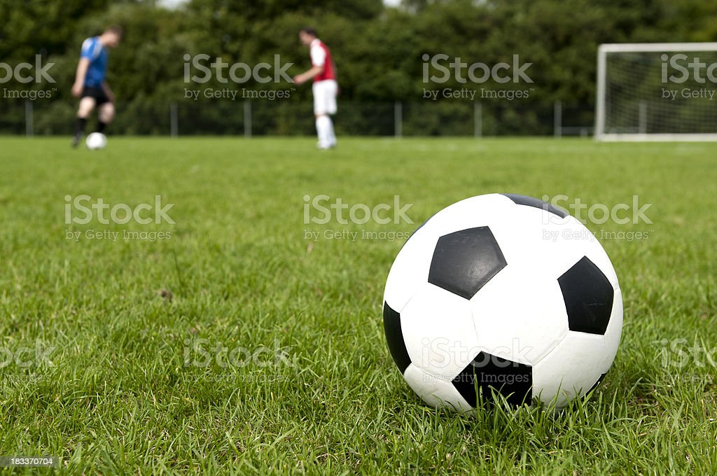 Playing soccer on a football field royalty-free stock photo