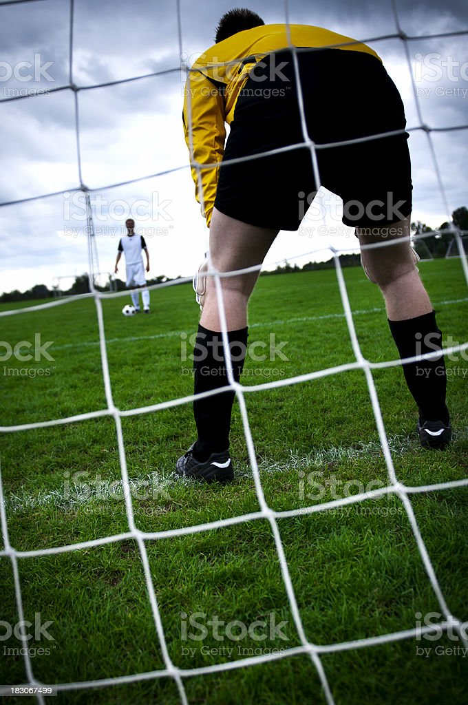 Playing soccer on football field royalty-free stock photo