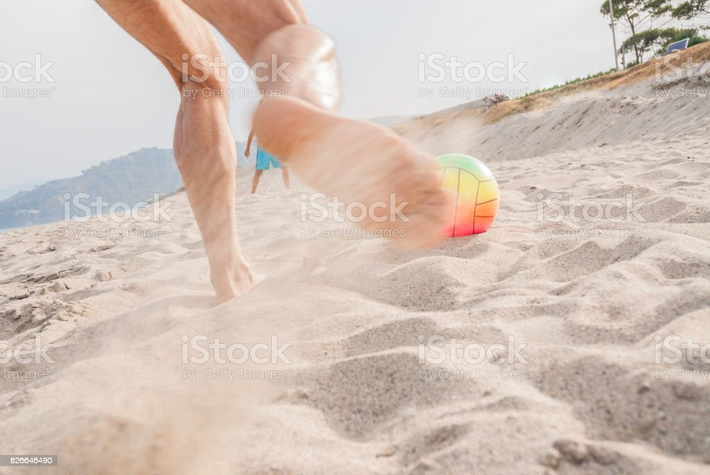 Playing Soccer on The Beach stock photo