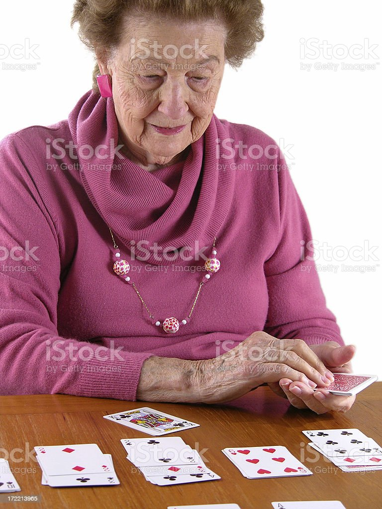 Playing Solitaire royalty-free stock photo