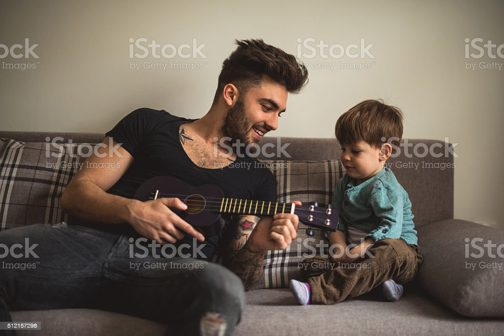 Playing song on a guitar stock photo