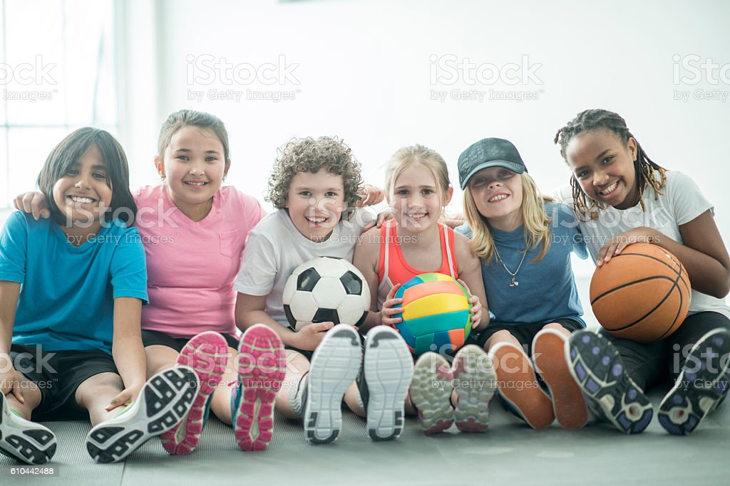 Playing Sports in the Gym stock photo