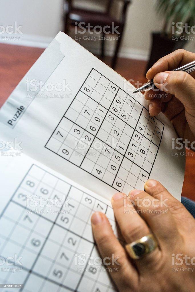 Playing sudoku stock photo
