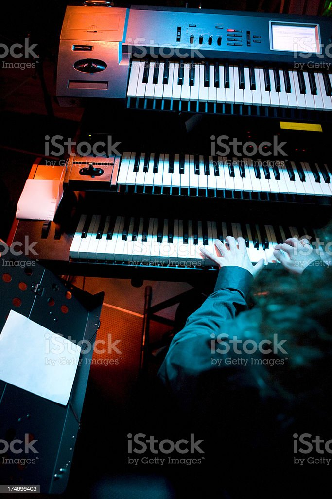 Playing synthesizer stock photo
