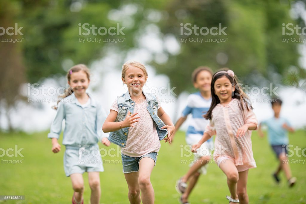 Playing Tag During Recess stock photo