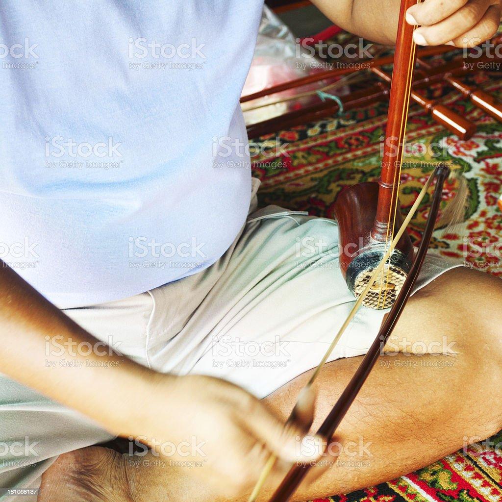 Playing Thai fidel royalty-free stock photo