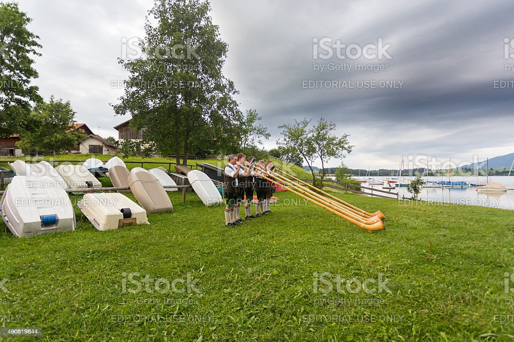 Playing the Alphorn royalty-free stock photo