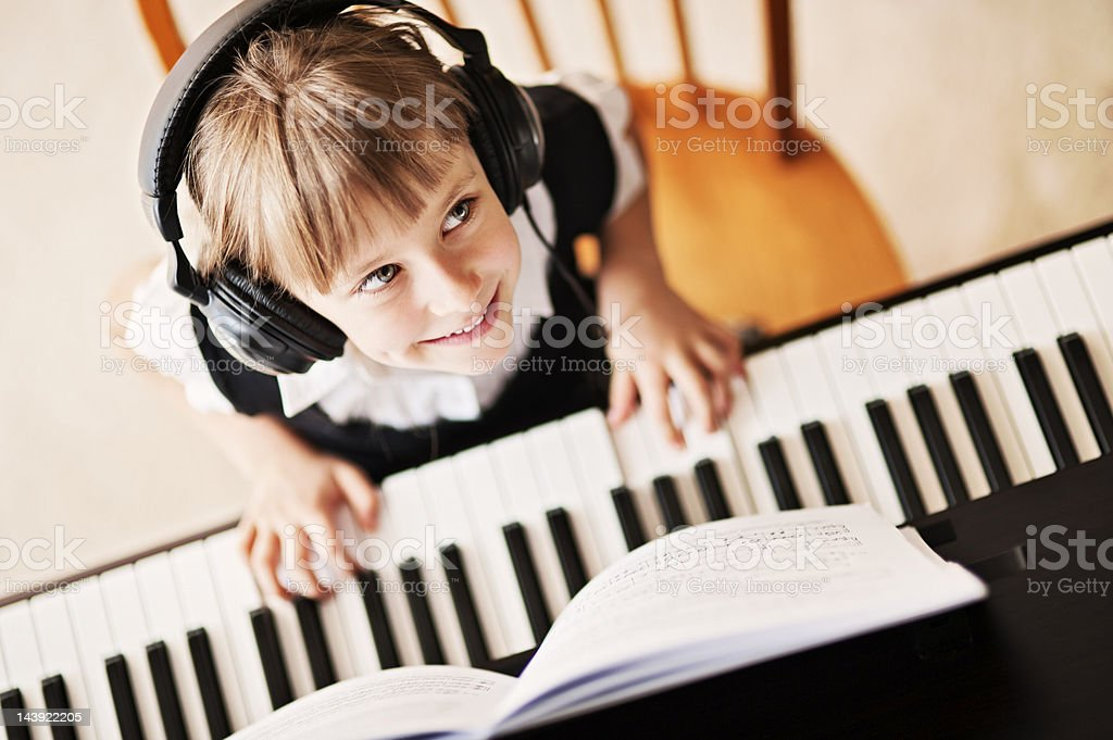 Playing the digital piano stock photo
