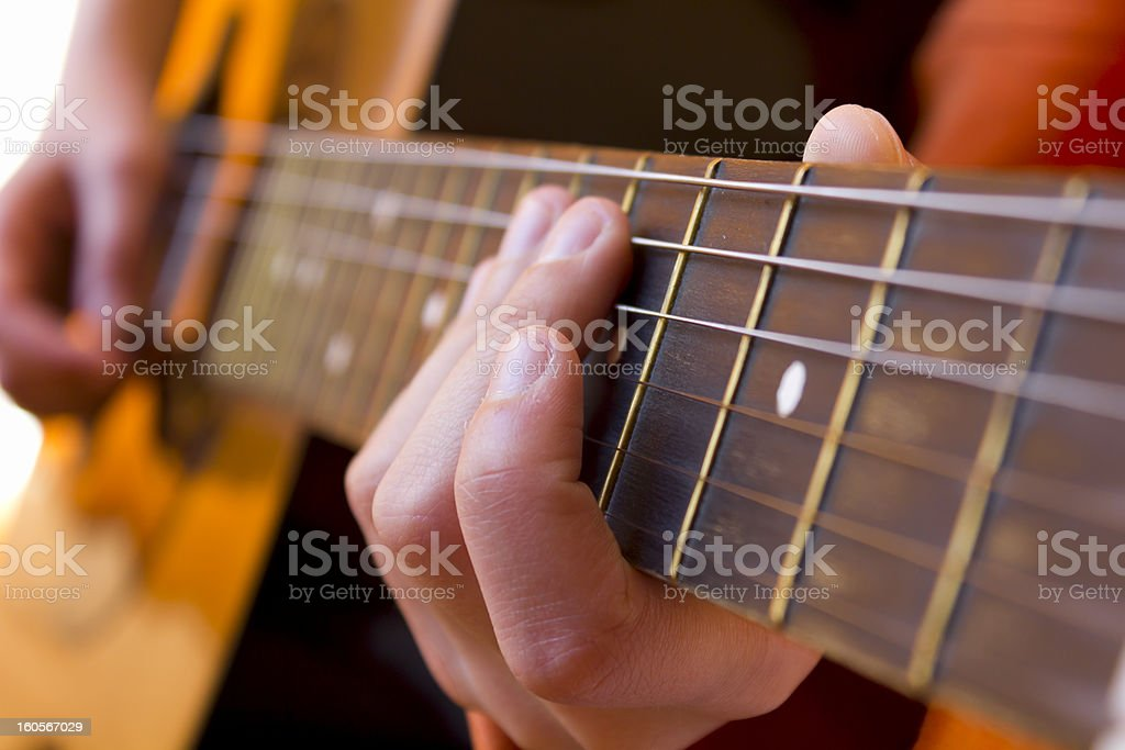Playing the guitar royalty-free stock photo