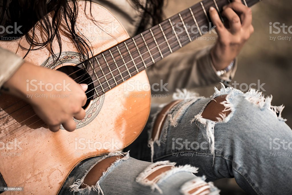 Playing the guitar stock photo