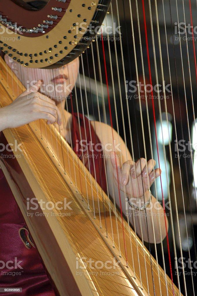 Playing the harp stock photo