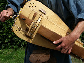 Playing the hurdy-gurdy close-up