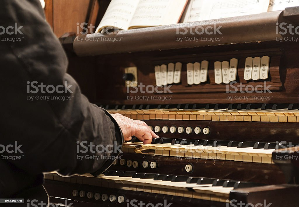 Playing the organ stock photo