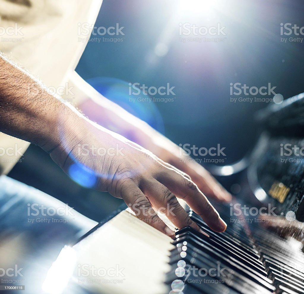 Playing the piano. stock photo