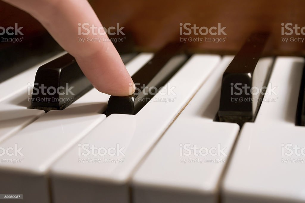 Playing the Piano (Shallow DOF) royalty-free stock photo
