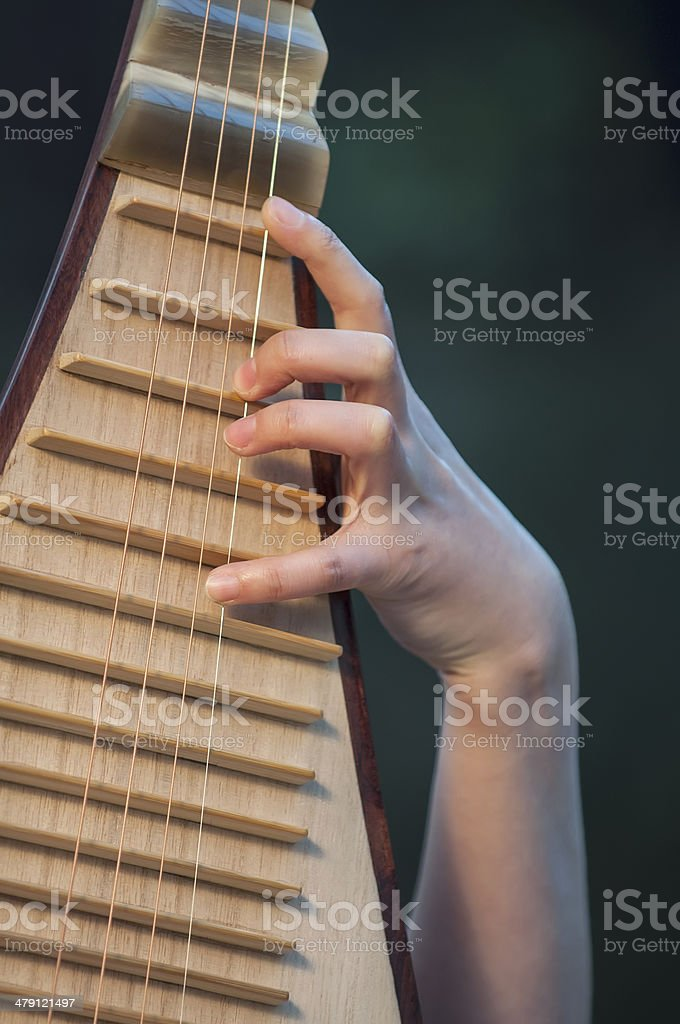Playing the pipa royalty-free stock photo