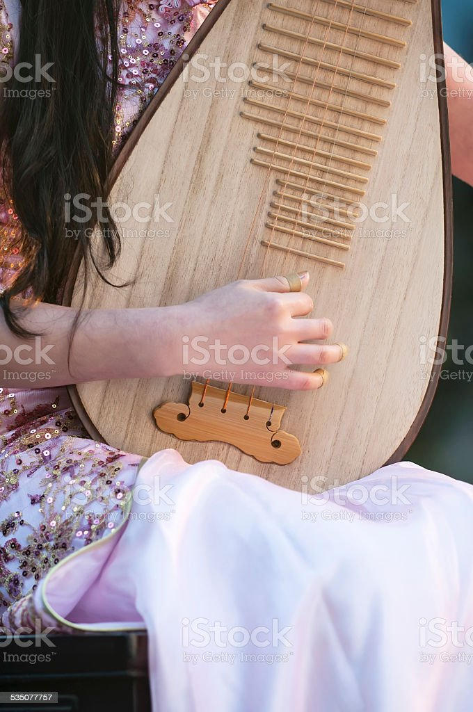 Playing the pipa stock photo