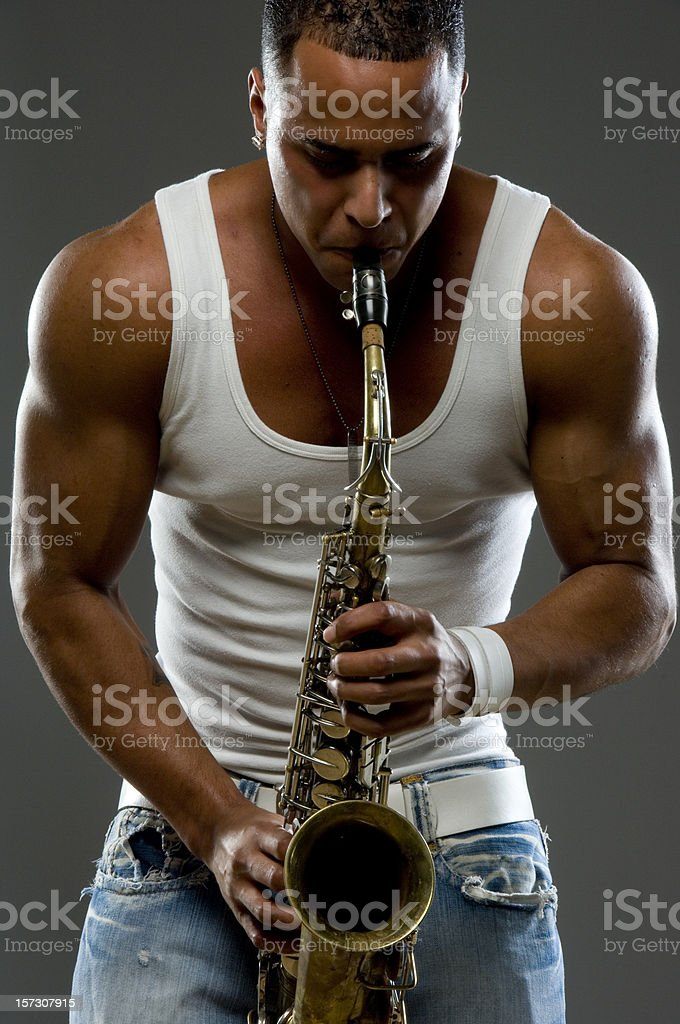 playing the saxophone stock photo