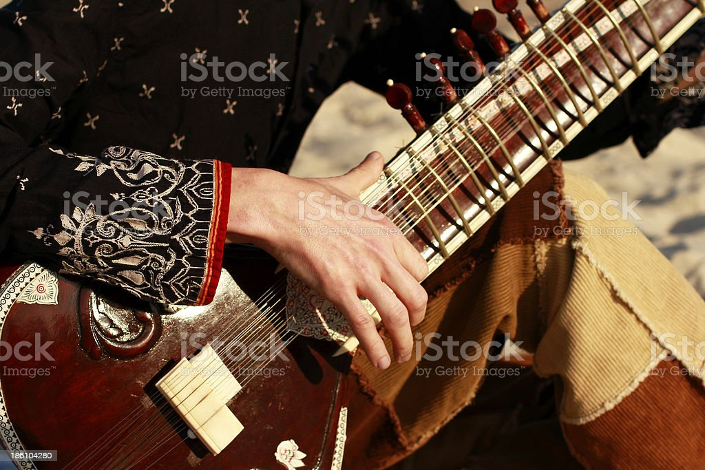 Playing the sitar stock photo