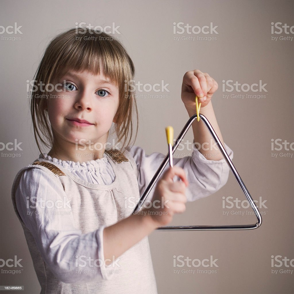 Playing the triangle royalty-free stock photo