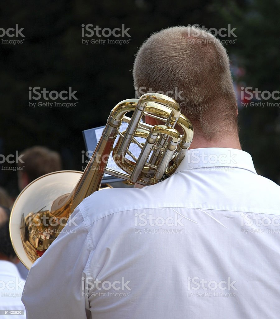 playing the trumpet stock photo