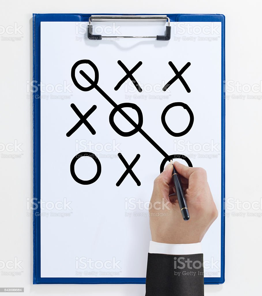 playing 'tic tac toe'on Clipboard stock photo