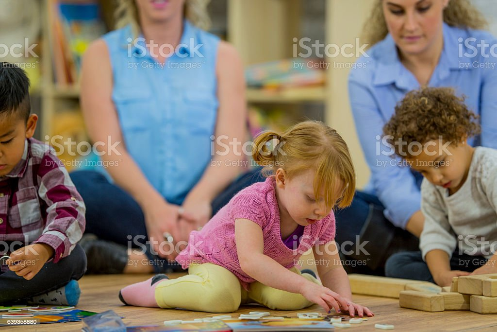 Playing Together in Preschool stock photo