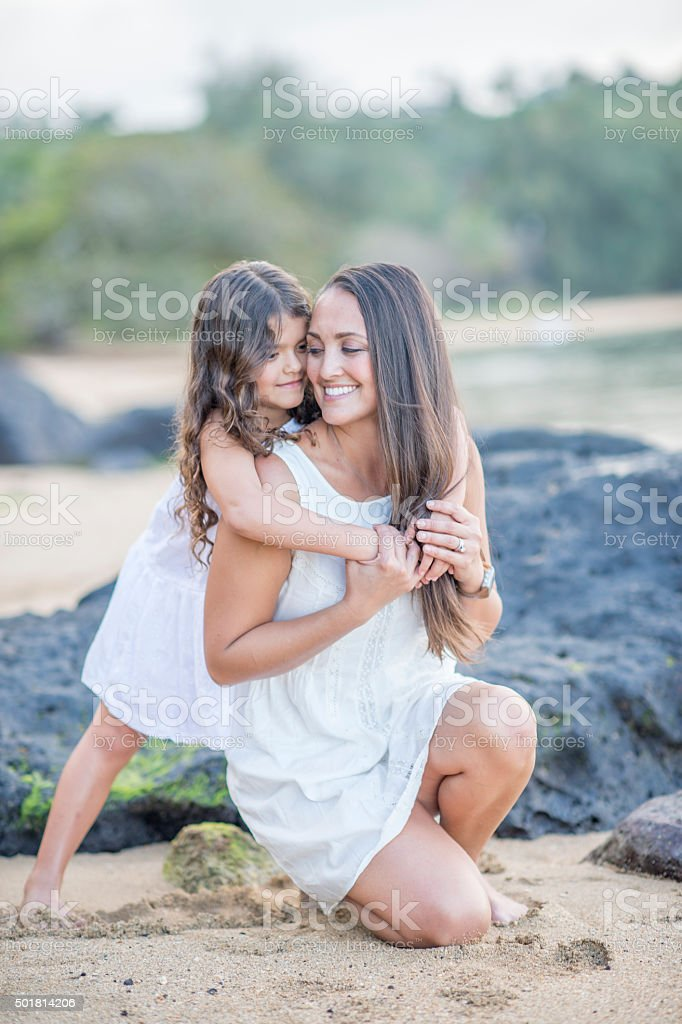 Playing Together on the Beach in Hawaii stock photo