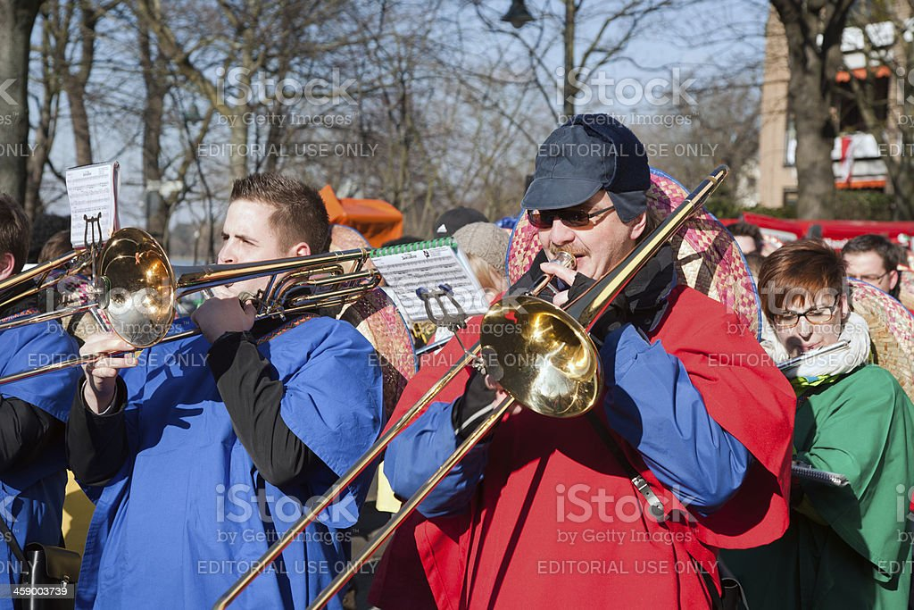 Playing trombone in carnival royalty-free stock photo