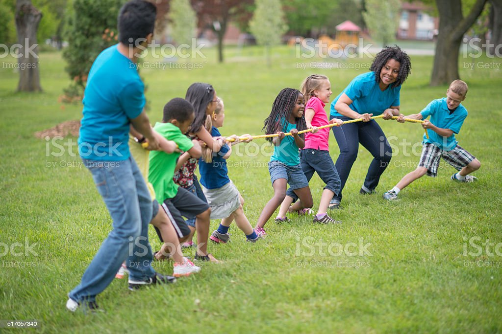 Playing tug-of-war at the Park stock photo