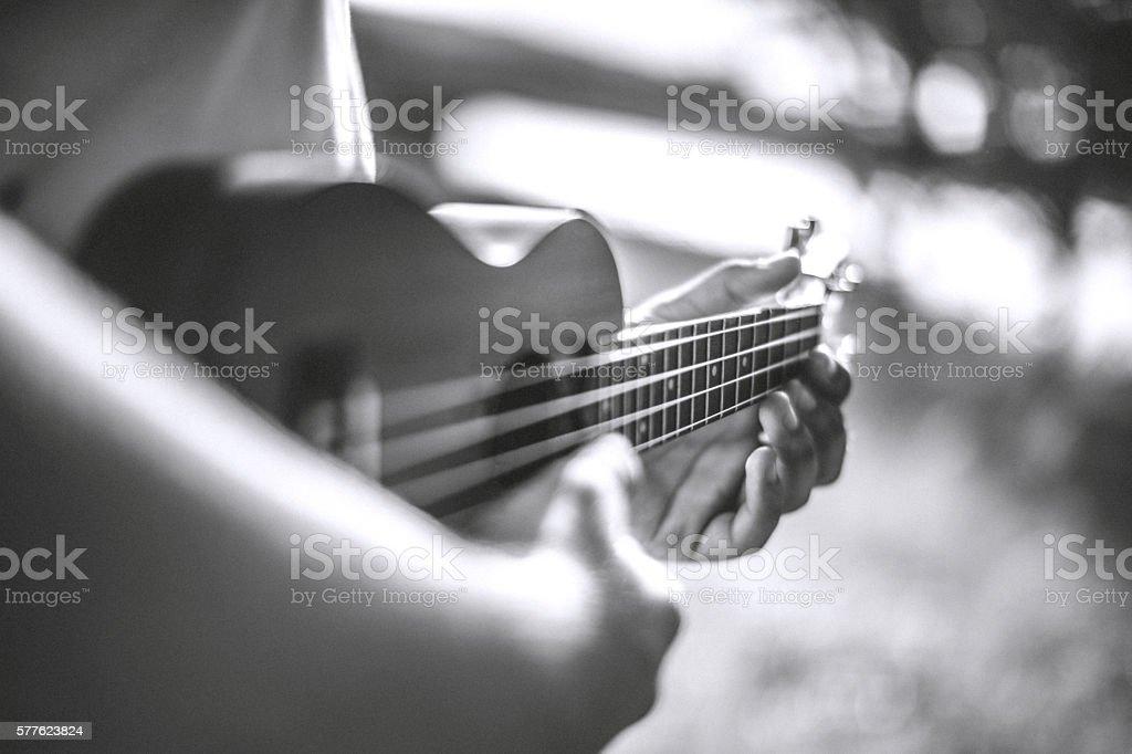 Playing ukelele stock photo