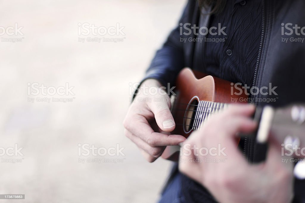Playing Ukulele royalty-free stock photo